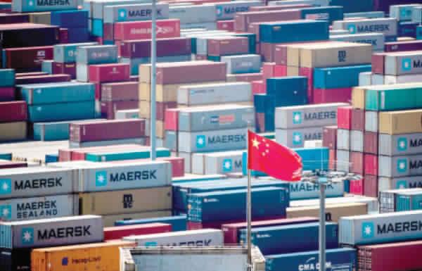 وزير التجارة الصيني: نرفض التفاوض مع واشنطن و«المسدس مصوب إلى رأسنا»