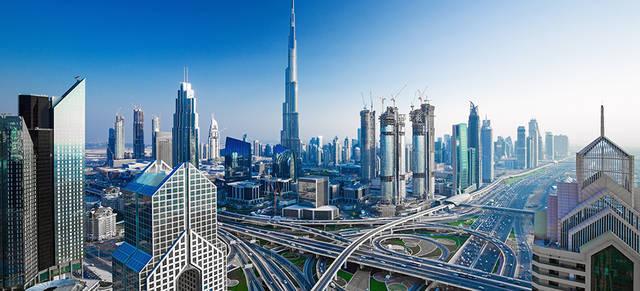 Dubai real estate deals fall more than half